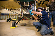 Joshua Knowlton of Ragwood Refactory working on restoring an Interstate Cadet.