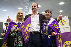 © Licensed to London News Pictures . 25/09/2015 . Doncaster , UK . DOUGLAS CARSWELL (c) with mother and daughter BETTY DEARDEN (r) and LESLEY NICHOLLS (l) (from Salford) at the 2015 UKIP Party Conference at Doncaster Racecourse , this morning (Friday 25th September 2015) . Photo credit : Joel Goodman/LNP