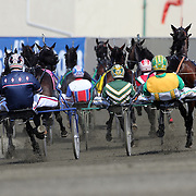 Drivers in the Hambletonian final negotiate a bend during the race won by the Driver Brian Sears and Royalty For Life, winning the $1.2 million Hambletonian final for 3-year-old trotters on at The Meadowlands Harness Racetrack, East Rutherford, New Jersey, USA.  3rd August 2013. Photo Tim Clayton