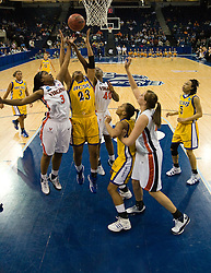 UCSB forward Ashlee Brown (23) battles with Virginia guard Paulisha Kellum (3) and guard Enonge Stovall (40) for a rebound.  The #4 seed/#24 ranked Virginia Cavaliers defeated the #13 seed Santa Barbara Gauchos 86-52 in the first round of the 2008 NCAA Division 1 Women's Basketball Championship at the Ted Constant Convocation Center in Norfolk, VA on March 23, 2008