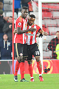 Papy Djilobodji (5) Sunderland AFC defender hugs goal scorer Jermain Defoe (18) Sunderland AFC striker after  the Premier League match between Sunderland and Leicester City at the Stadium Of Light, Sunderland, England on 3 December 2016. Photo by Ian Lyall.