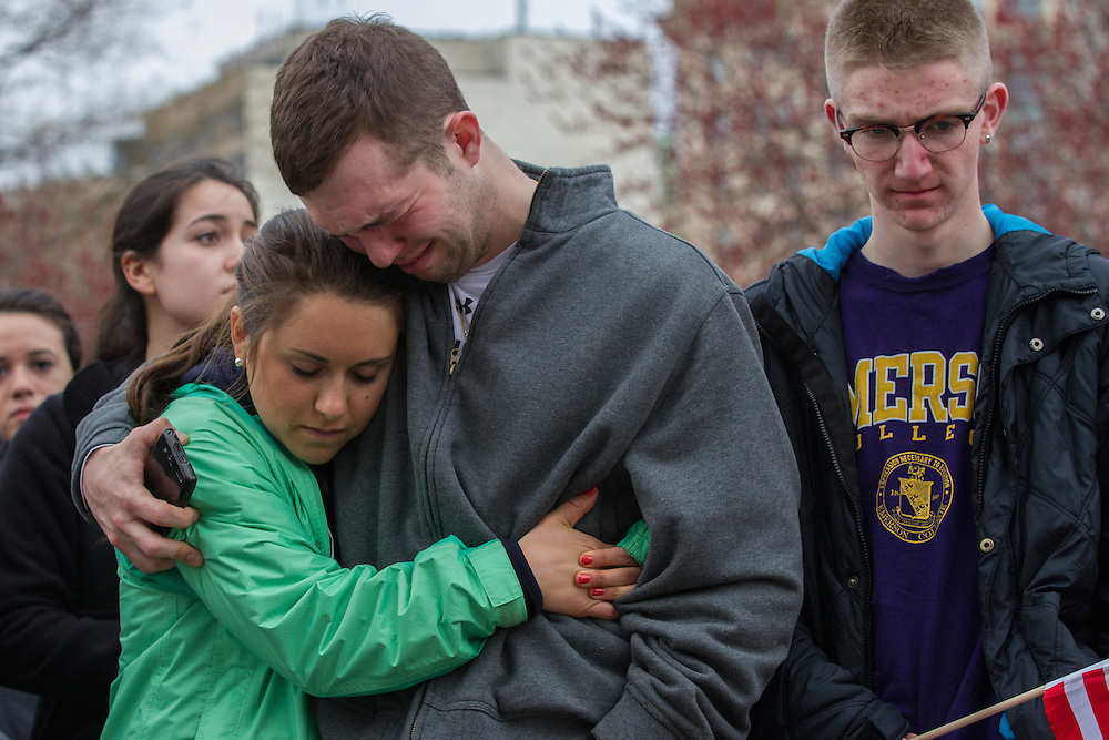 Mourners embrace during a vigil for the victim's of Monday's terrorist bombings near the finish line of the Boston Marathon, on Boston Common in Boston, MA on Tuesday, April 16, 2013.  (Matthew Cavanaugh for The Washington Post)