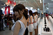 Hostesses ending their shift at the Seoul Photo Fair 2011.