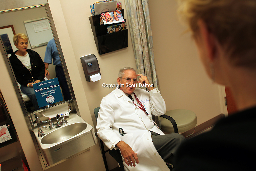 Dr. Martin Raber sees one of his patients at the MD Anderson Cancer Center in Houston, TX on October 1, 2009. Dr. Raber was diagnosed with lymphoma, he was treated at his own hospital, now a cancer survivor he provides a unique perspective for his patients drawn from his own experiences as a doctor and cancer survivor. (Photo/Scott Dalton)