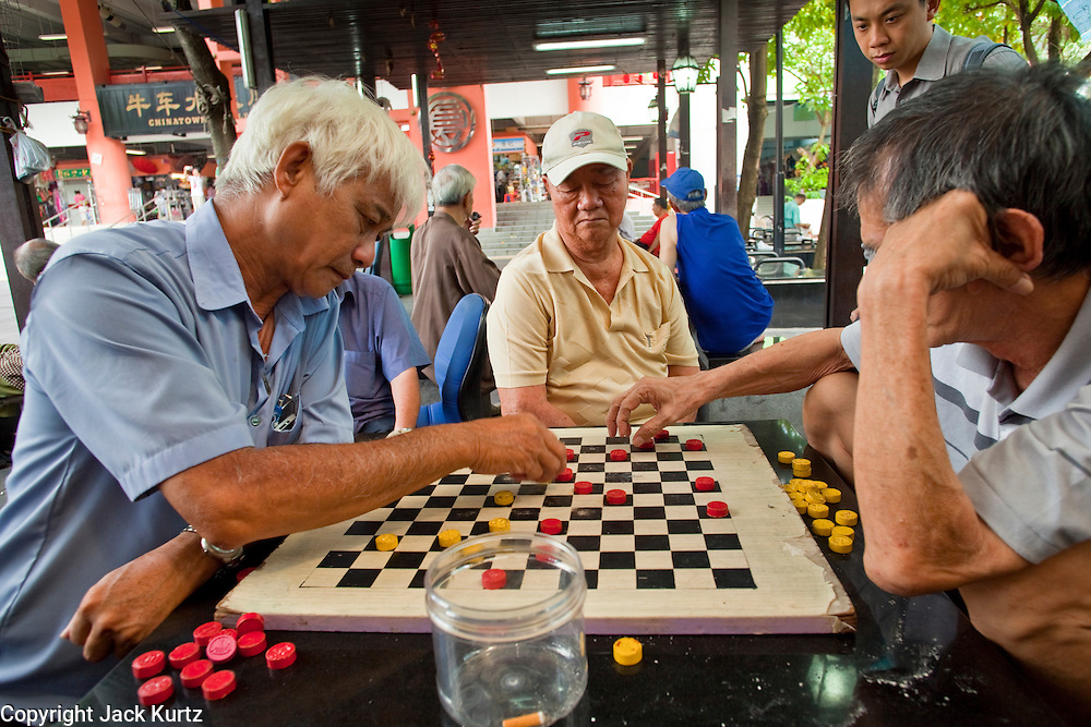 Apr. 28 -- SINGAPORE:  Men play checkers in the Chinatown neighborhood of Singapore.    PHOTO BY JACK KURTZ