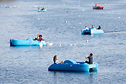 UNITED KINGDOM, London: 26 February 2019. People enjoy pedalos on The Serpentine in Hyde Park on what is set to be the warmest day in February since records began. Temperatures are set to reach up to 20 degrees Celsius in the capital today. Rick Findler / Story Picture Agency