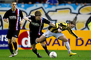 Onderwerp/Subject: Vitesse - Willem II      Eredivisie<br /> Reklame: <br /> Club/Team/Country: Vitesse - Willem II<br /> Seizoen/Season: 2009/2010<br /> FOTO/PHOTO: Vitesse's Alexander BUTTNER (R) in duel with Willem II's Jan Arie VAN DER HEIJDEN (L) (Photo by PICS UNITED/Aaron van Zandvoort)<br /> <br /> Trefwoorden/Keywords: <br /> #04 $28 &plusmn;1261427875599<br /> Photo- &amp; Copyrights &copy; PICS UNITED<br /> P.O. Box 7164 - 5605 BE  EINDHOVEN (THE NETHERLANDS)<br /> Phone +31 (0)40 296 28 00<br /> Fax +31 (0) 40 248 47 43<br /> http://www.pics-united.com<br /> e-mail : sales@pics-united.com (If you would like to raise any issues regarding any aspects of products / service of PICS UNITED) or<br /> e-mail : sales@pics-united.com <br /> <br /> ATTENTIE:<br /> Publicatie ook bij aanbieding door derden is slechts toegestaan na verkregen toestemming van Pics United.<br /> VOLLEDIGE NAAMSVERMELDING IS VERPLICHT! (&copy; PICS UNITED/Naam Fotograaf, zie veld 4 van de bestandsinfo 'credits')<br /> ATTENTION: <br /> &copy; Pics United. Reproduction/publication of this photo by any parties is only permitted after authorisation is sought and obtained from  PICS UNITED- THE NETHERLANDS