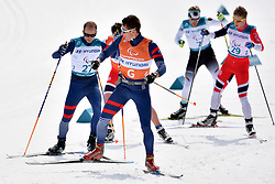 CHALENCON Anthony FRA B1 Guide: VALVERDE Simon competing in the ParaSkiDeFond, Para Nordic Skiing, 20km at  the PyeongChang2018 Winter Paralympic Games, South Korea.