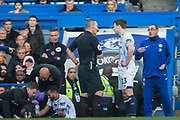 Kevin Friend (Referee) talking with Seamus Coleman (Capt) (Everton) with Maurizio Sarri Head Coach of Chelsea FC in the background during the Premier League match between Chelsea and Everton at Stamford Bridge, London, England on 11 November 2018.