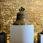 Some of the historic bells on display iin a chamber of the Belfry of Bruges. The Belfry (or Belfort) is a medieval bell tower standing above the Markt in the historic center of Bruges. The first stage was built in 1240, with further stages on top built in the late 15th century. The Carillon consists of 47 bells. 26 bells were cast by Georgius Dumery between 1742 and 1748 and 21 bells were cast by Koninklike Eijsbouts in 2010. The bourdon weights 6 tons, and the bells have a combined weight of 27 tons.