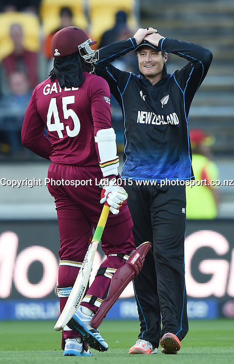 Martin Guptill and Chris Gayle during the ICC Cricket World Cup quarter final match between New Zealand Black Caps and the West Indies, Wellington, New Zealand. Saturday 21March 2015. Copyright Photo: Andrew Cornaga / www.Photosport.co.nz