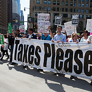 Several thousand people marched to Trump International Hotel and Tower Chicago asking President Donald J. Trump to release his income tax returns. Others protested against the President's anti-immigration policies. <br /> Photography by Jose More
