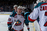 KELOWNA, CANADA - JANUARY 9:  Michael Farren #16 of the Kelowna Rockets fist bumps the bench to celebrate a second period tying goal against the Everett Silvertips on January 9, 2019 at Prospera Place in Kelowna, British Columbia, Canada.  (Photo by Marissa Baecker/Shoot the Breeze)