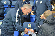 Blackburn Rovers Manager, Paul Lambert signs young fans autographs during the Sky Bet Championship match between Blackburn Rovers and Sheffield Wednesday at Ewood Park, Blackburn, England on 28 November 2015. Photo by Mark Pollitt.
