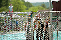 The boy scouts raise the American flag up the flagpole during the 70th Anniversary celebration of the Kiwanis Pool in St. Johnsbury Vermont.  Karen Bobotas / for Kiwanis International