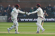 Steve Davies of Somerset touches gloves with Tom Abell of Somerset as they build a partnership during the Specsavers County Champ Div 1 match between Somerset County Cricket Club and Kent County Cricket Club at the Cooper Associates County Ground, Taunton, United Kingdom on 7 April 2019.