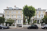"""London, England, UK, June 5 2018 - Semi-detached houses on Tregunter Road in the Chelsea area, one of the richest residential neighborhood in London. Due to strict regulations on the height of the buildings and high cost of housing, honeowners burrow down to build or extend basements. Even though the Royal Borough of Kensington and Chelsea have restricted the digging to one floor underground, they allow to dig as low as 17meters under the ground level and create split """"levels"""". Tregunter Road is the street with the highest permit in Chelsea for basement digging."""