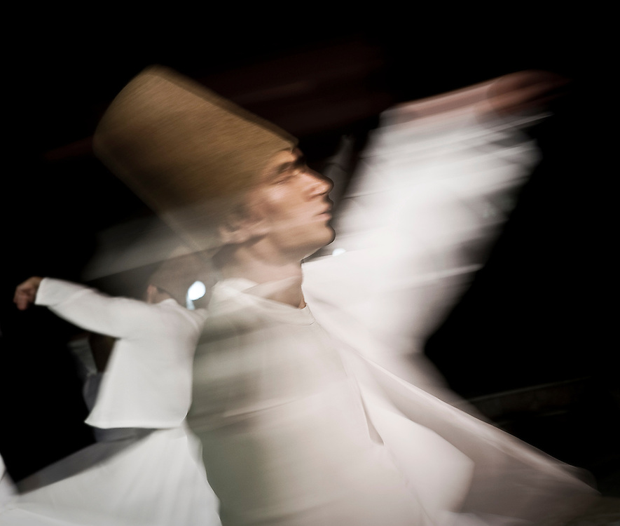 "A dervish performs the Sema Ceremony, in front of the Mevlana Mausoleum, in the city of Konya, Turkey. Sufism is a mystical tradition of Islam. Also considered as a spiritual and ascetic movement of Islam with esoteric doctrines appeared during the VIII century. The Muslim Sufis are people who privilege internalization, the love of god, contemplation and wisdom. A practitioner of this tradition is generally known as a Sufi, another name used for the Sufi seeker is ""dervish"". The Sufi movement has spanned several continents and cultures over a millennium, at first expressed through Arabic, then through Persian, Turkish, and a dozen other languages. Sufi orders, most of which are Sunni in doctrine, trace their origins from the Prophet of Islam, Muhammad, through his cousin Ali or his father-in-law Abu Bakr. According to some modern proponents, the Sufi philosophy is universal in nature and its roots predate the arising of the modern-day religions. The whirling dance or Sufi whirling that is associated with dervishes, is the practice of the Mevlevi Order in Turkey, and is just one of the physical methods used to try and reach religious ecstasy. Condemned by traditional Islam, the Sufism cultivates the mystery; the idea being that Muhammad would have received at the same time the Koran and esoteric revelations."