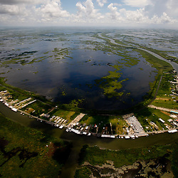 The small town of Delacroix, Louisiana, U.S., is seen from the air during a U.S. Coast Guard overflight in a C-144 aircraft on Monday, July 26, 2010. Photographer: Derick E. Hingle