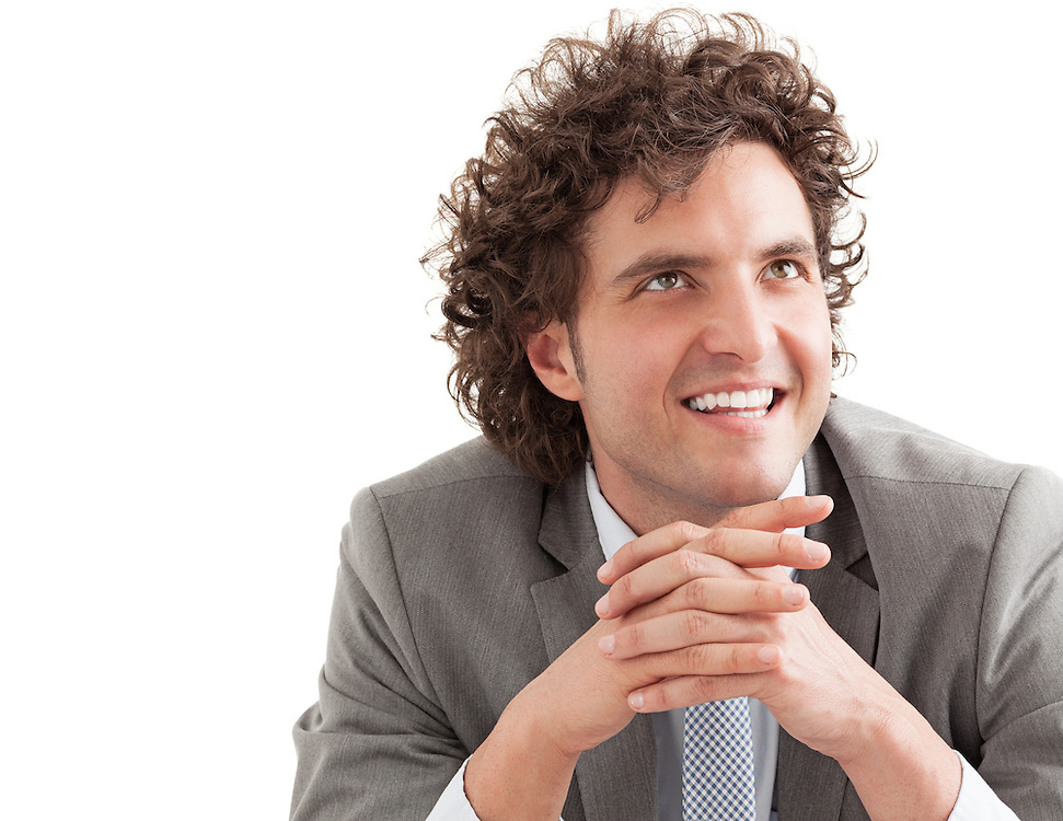 Portrait of a confident young businessman sitting with his hands crossed.