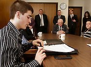 Pine Bush High School student Nicholas Doran reads a statement during a meeting with state Sen. Bill Larkin, seated at table at center, in Larkin's office in Albany on Monday, March 1, 2010. Assemblywoman Nancy Calhoun also listened to students at the meeting.