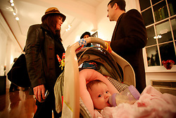 04 February, 2006. New Orleans, Louisiana. <br /> Baby Alaina peers from her stroller at an uptown art gallery where signs of normalcy have returned to the otherwise devastated city.<br /> Photo; Charlie Varley/varleypix.com