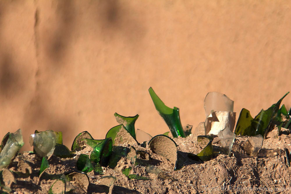 Africa, Morocco, Skoura. Broken glass bottles on kasbah walls.