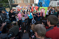 © Licensed to London News Pictures. 18/09/2011. Crays Hill, UK. Residents of Dale Farm talk to the media at the entrance to the site this evening (18/09/2011) the night before they are due to be evicted. Around 80 traveller families will be removed from the UK's largest illegal traveller site. Photo credit: Ben Cawthra/LNP