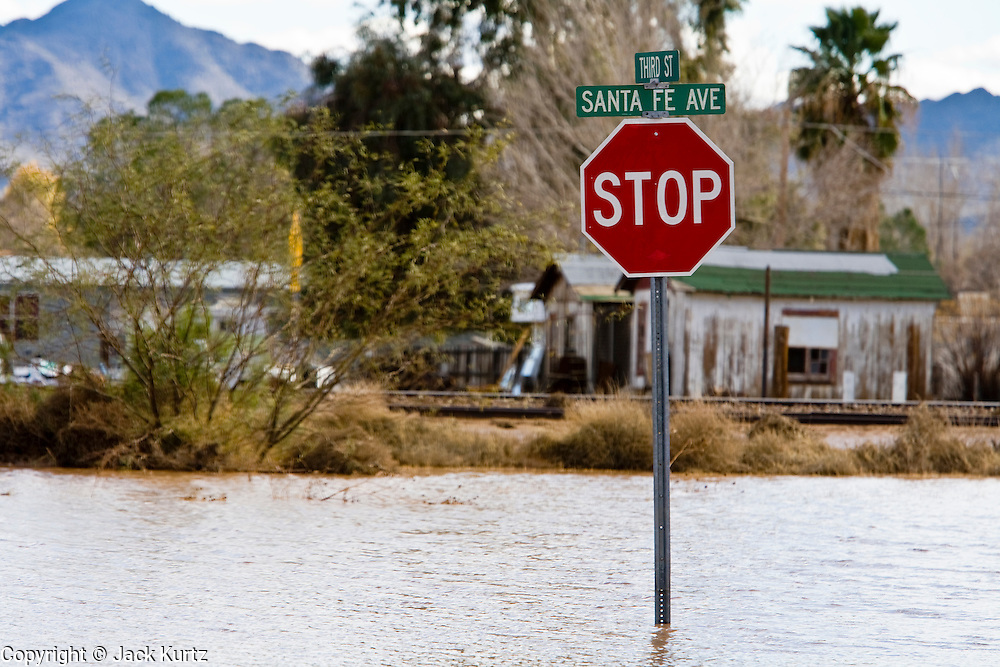 24 JANUARY 2010 -- WENDEN, AZ:  Streets in Wenden show the signs of flooding. Wenden was slammed by its second 100 year flood in 10 years on Thursday night when water raced through Centennial Wash and into the small town in La Paz County west of Phoenix. Most of the town's residents were evacuated to Red Cross shelters in Salome, about 5 miles west of Wenden.   PHOTO BY JACK KURTZ