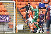 Bradford City goalkeeper Colin Doyle (1) fumbles the cross under challenge from Blackpool striker Mark Cullen (9) and allows Blackpool midfielder Sean Longstaff (15) to scores a goal 5-0 during the EFL Sky Bet League 1 match between Blackpool and Bradford City at Bloomfield Road, Blackpool, England on 7 April 2018. Picture by Craig Galloway.