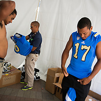 UCLA football quarterback Brett Hundley and linebacker Eric Kendricks, left, prepare for a long day of photos and interviews at the Pac12 Media Day held at Paramount Studios.