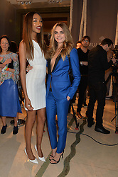 Left to right, JOURDAN DUNN and CARA DELEVINGNE at a Dinner to celebrate the launch of the Mulberry Cara Delevingne Collection held at Claridge's, Brook Street, London on 16th February 2014.