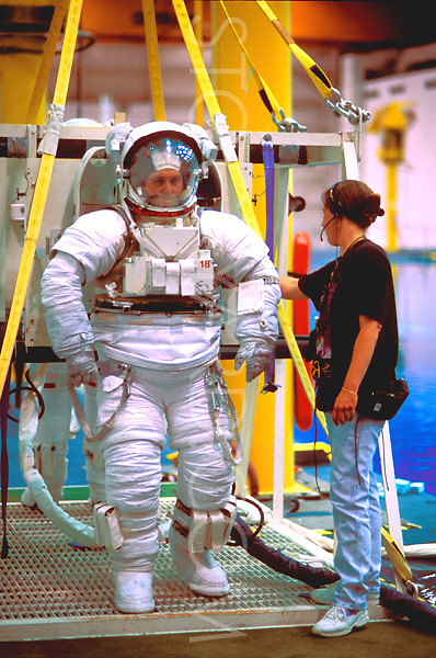 Stock photo of a man preparing to be lowered into the pool at the NASA Neutral Buoyancy Lab in Houston Texas