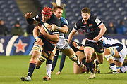 Grant Gilchrist is tackled by Jacques Du Plessis during the Heineken Champions Cup match between Edinburgh Rugby and Montpellier Herault Rugby at BT Murrayfield Stadium, Edinburgh, Scotland on 18 January 2019.