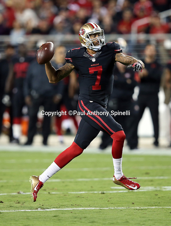 San Francisco 49ers quarterback Colin Kaepernick (7) fakes a pass and runs the ball on a keeper during the 2015 NFL week 1 regular season football game against the Minnesota Vikings on Monday, Sept. 14, 2015 in Santa Clara, Calif. The 49ers won the game 20-3. (©Paul Anthony Spinelli)