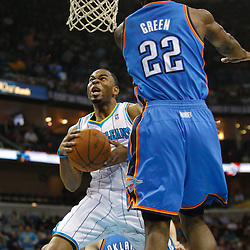 January 24,  2011; New Orleans, LA, USA; New Orleans Hornets guard Marcus Thornton (5) shoots over Oklahoma City Thunder forward Jeff Green (22) during the second quarter at the New Orleans Arena. Mandatory Credit: Derick E. Hingle