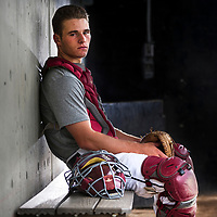 ORIG 06/20/18 Elks' catcher Brett Auerbach sits in the teams dugout at Vince Genna Stadium on Wednesday, June 20, 2018. (Ryan Brennecke/Bulletin photo)