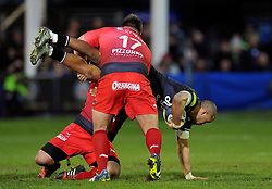 Jonathan Joseph of Bath Rugby is upended in a tackle by Xavier Chiocci of Toulon - Mandatory byline: Patrick Khachfe/JMP - 07966 386802 - 23/01/2016 - RUGBY UNION - The Recreation Ground - Bath, England - Bath Rugby v RC Toulon - European Rugby Champions Cup.