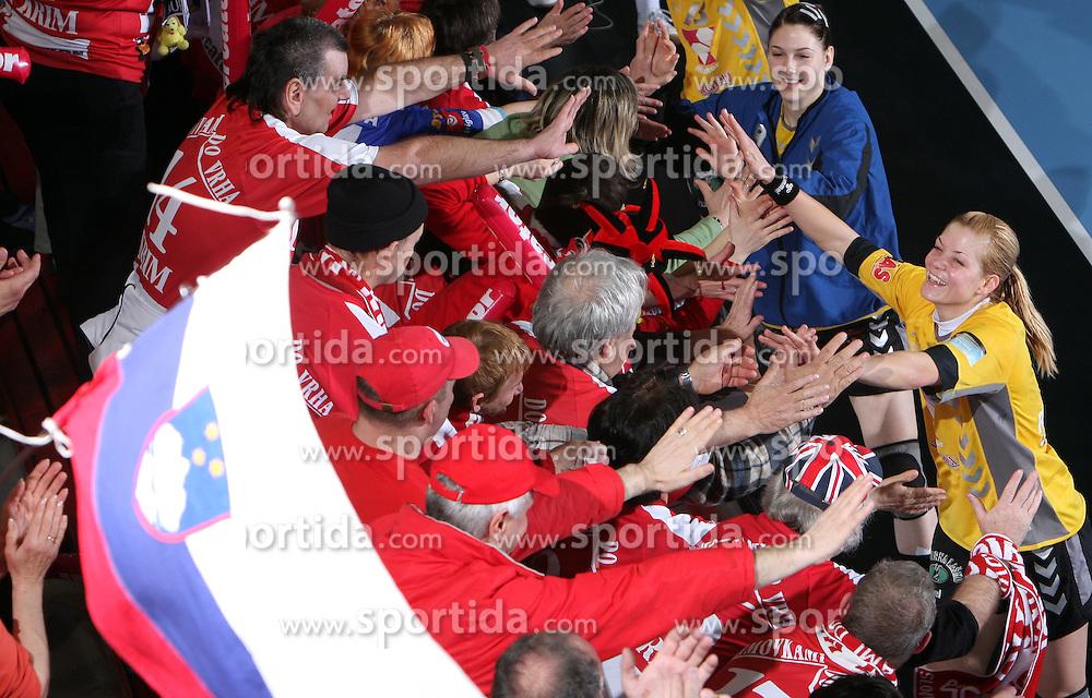 Tamara Mavsar and Spela Cerar with fans  Krimovci after handball match at Main round of Champions League between RK Krim Mercator, Ljubljana and CS Oltchim Rm. Valcea, Romania, in Arena Kodeljevo, Ljubljana, Slovenia, on 28th of February 2009. Krim won 35:34.
