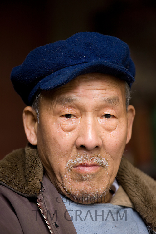 Chinese man in Fuli Old Town, Xingping, China