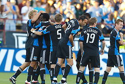 July 20, 2011; Santa Clara, CA, USA;  San Jose Earthquakes forward Chris Wondolowski (left) is congratulated by teammates after scoring a goal against the Vancouver Whitecaps during the first half at Buck Shaw Stadium.