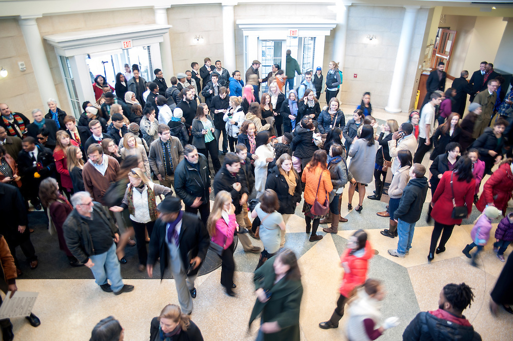Participants of a silent march in honor of Dr. Martin Luther King Jr, disperse on the fourth floor of Baker University Center on Monday, January 19.
