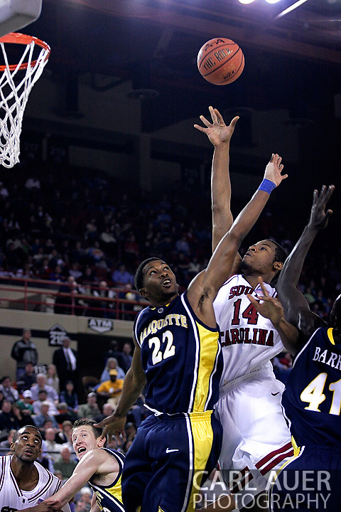 26 November 2005: USC Gamecock senior forward/center, Antoine Tisby (14), takes a shot over Marquette's Jerel McNeal (22) in the South Carolina Gamecock overtime loss, 89-92, to the Golden Eagles of Marquette in the final game of the Great Alaska Shootout in Anchorage, Alaska