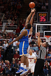 Dec 29, 2011; Stanford CA, USA;  UCLA Bruins center Joshua Smith (34) wins the opening tip off from Stanford Cardinal forward/center Jack Trotter (back) during the first half at Maples Pavilion.  Mandatory Credit: Jason O. Watson-US PRESSWIRE