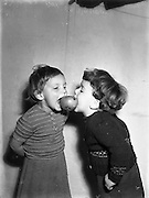 Two children playing snap apple on Halloween at Botanic Road, Glasnevin on the 28th of October 1960.