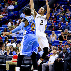 Mar 31, 2016; New Orleans, LA, USA; New Orleans Pelicans guard Tim Frazier (2) shoots over Denver Nuggets guard D.J. Augustin (12) during the second half of a game at the Smoothie King Center. The Pelicans defeated the Nuggets 101-95. Mandatory Credit: Derick E. Hingle-USA TODAY Sports