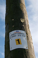 Faulty lights sign on lamp post