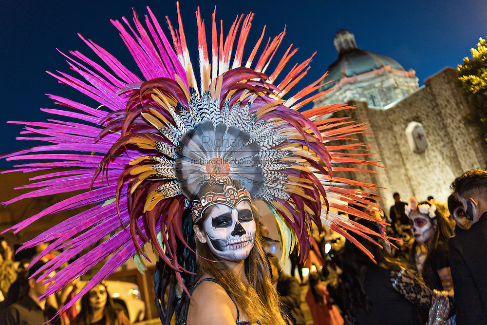 A young woman dressed as an Aztec skeleton during the Day of the Dead festival in the Plaza Civica October 28, 2016 in San Miguel de Allende, Guanajuato, Mexico. The week-long celebration is a time when Mexicans welcome the dead back to earth for a visit and celebrate life.
