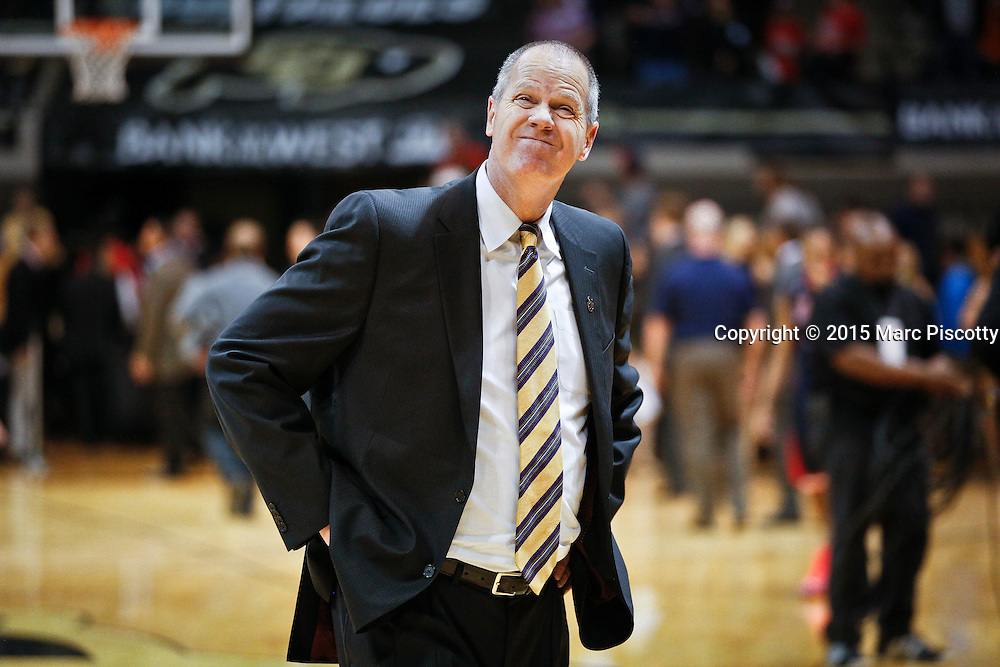 SHOT 2/26/15 10:03:31 PM - Colorado head basketball coach Tad Boyle reacts to a loss after their regular season Pac-12 basketball game against Arizona at the Coors Events Center in Boulder, Co. Arizona won the game 82-54.<br /> (Photo by Marc Piscotty / &copy; 2015)