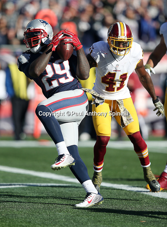 Washington Redskins cornerback Will Blackmon (41) looks on as New England Patriots running back LeGarrette Blount (29) high steps into the end zone as he runs for a 5 yard touchdown that gives the Patriots a 14-0 first quarter lead during the 2015 week 9 regular season NFL football game against the Washington Redskins on Sunday, Nov. 8, 2015 in Foxborough, Mass. The Patriots won the game 27-10. (©Paul Anthony Spinelli)
